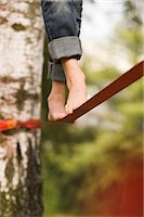 Woman on Slackline Stock Photo - Premium Rights-Managed, Artist: Bryan Reinhart, Code: 700-03179165