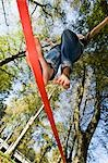 Boy Slacklining Stock Photo - Premium Rights-Managed, Artist: Bryan Reinhart, Code: 700-03179171