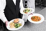 Waiter holding plates of foods Stock Photo - Premium Rights-Managed, Artist: Glowimages, Code: 837-03182799