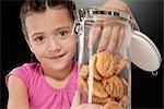 Girl putting her hand into a cookie jar Stock Photo - Premium Rights-Managed, Artist: Glowimages, Code: 837-03182925