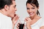Couple sharing a cola beverage Stock Photo - Premium Rights-Managed, Artist: Glowimages, Code: 837-03184119
