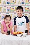 Portrait of a boy and girl with a platter of nachos Stock Photo - Premium Rights-Managed, Artist: Glowimages, Code: 837-03184164