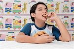 Portrait of a boy eating a cookie Stock Photo - Premium Rights-Managed, Artist: Glowimages, Code: 837-03184200