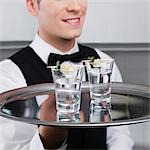 Waiter holding a tray of tequila shots Stock Photo - Premium Rights-Managed, Artist: Glowimages, Code: 837-03184272
