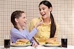 Woman with her daughter having breakfast Stock Photo - Premium Rights-Managed, Artist: Glowimages, Code: 837-03184633