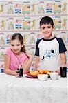 Portrait of a boy and girl with a platter of nachos Stock Photo - Premium Rights-Managed, Artist: Glowimages, Code: 837-03184645
