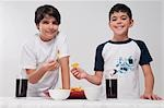 Portrait of two boys eating nachos Stock Photo - Premium Rights-Managed, Artist: Glowimages, Code: 837-03185143