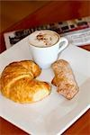High angle view of a croissant and sugar cracker with a cup of coffee Stock Photo - Premium Rights-Managed, Artist: Glowimages, Code: 837-03185155