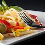 Close-up of spaghetti with bell peppers and olives Stock Photo - Premium Rights-Managed, Artist: Glowimages, Code: 837-03185167