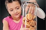 Girl putting her hand into a cookie jar Stock Photo - Premium Rights-Managed, Artist: Glowimages, Code: 837-03185412