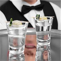 Waiter holding a tray of tequila shots Stock Photo - Premium Rights-Managednull, Code: 837-03185492