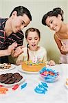 Girl celebrating her birthday with her parents Stock Photo - Premium Rights-Managed, Artist: Glowimages, Code: 837-03185727