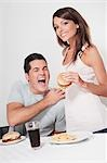 Couple eating hamburgers Stock Photo - Premium Rights-Managed, Artist: Glowimages, Code: 837-03185941