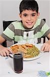 Portrait of a boy having lunch Stock Photo - Premium Rights-Managed, Artist: Glowimages, Code: 837-03186082
