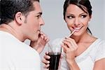 Couple sharing a cola beverage Stock Photo - Premium Rights-Managed, Artist: Glowimages, Code: 837-03186172