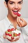 Portrait of a woman eating strawberries in cream Stock Photo - Premium Rights-Managed, Artist: Glowimages, Code: 837-03186404