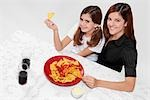 Portrait of a woman and her daughter eating nachos with salsa Stock Photo - Premium Rights-Managed, Artist: Glowimages, Code: 837-03186871