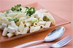 Close-up of pasta in a plate with tableware Stock Photo - Premium Rights-Managed, Artist: Glowimages, Code: 837-03186935