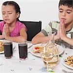 Boy and his sister praying before lunch Stock Photo - Premium Rights-Managed, Artist: Glowimages, Code: 837-03186989