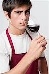 Close-up of a man smelling a glass of red wine Stock Photo - Premium Rights-Managed, Artist: Glowimages, Code: 837-03187150