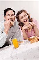 preteens fingering - Man with his daughter at a breakfast table Stock Photo - Premium Rights-Managednull, Code: 837-03187184