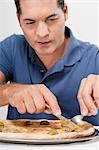 Man eating pizza with a fork and knife Stock Photo - Premium Rights-Managed, Artist: Glowimages, Code: 837-03187186