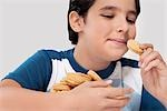 Close-up of a boy eating a cookie Stock Photo - Premium Rights-Managed, Artist: Glowimages, Code: 837-03187234