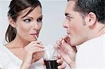 Couple sharing a cola beverage Stock Photo - Premium Rights-Managed, Artist: Glowimages, Code: 837-03187601