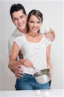 Couple preparing food in the kitchen Stock Photo - Premium Rights-Managednull, Code: 837-03187791