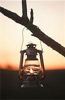 Hanging paraffin lantern at sunset, Zimbabwe Stock Photo - Premium Royalty-Freenull, Code: 682-03188220