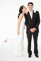 female white background full body - Bride kissing the groom Stock Photo - Premium Royalty-Freenull, Code: 614-03191737