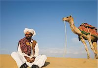 rajasthan camel - Man with a camel in a desert, Thar Desert, Jaisalmer, Rajasthan, India Stock Photo - Premium Rights-Managednull, Code: 857-03192650