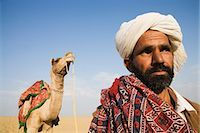 rajasthan camel - Close-up of a man with a camel in the background, Thar Desert, Jaisalmer, Rajasthan, India Stock Photo - Premium Rights-Managednull, Code: 857-03192653
