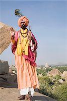 Low angle view of a sadhu blessing, Hampi, Karnataka, India Stock Photo - Premium Rights-Managednull, Code: 857-03192782