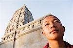 Monk thinking with a temple in the background, Mahabodhi Temple, Bodhgaya, Gaya, Bihar, India Stock Photo - Premium Rights-Managed, Artist: Photosindia, Code: 857-03192930