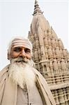 Portrait of a sadhu with a temple in the background, Scindia Ghat, Ganges River, Varanasi, Uttar Pradesh, India Stock Photo - Premium Rights-Managed, Artist: Photosindia, Code: 857-03192997