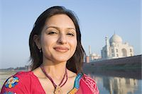Portrait of a woman with a mausoleum in the background, Taj Mahal, Agra, Uttar Pradesh, India Stock Photo - Premium Rights-Managednull, Code: 857-03193083