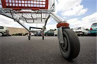 empty shopping cart - Shopping cart in parking lot, surface level view Stock Photo - Premium Royalty-Freenull, Code: 632-03193726