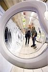 Shoppers seen through open washing machine door Stock Photo - Premium Royalty-Free, Artist: Minden Pictures, Code: 632-03193738