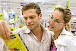 Couple looking at DVD together in store Stock Photo - Premium Royalty-Free, Artist: I. Jonsson, Code: 632-03193772