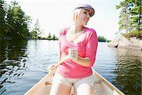 Woman Canoeing on Kahshe Lake, Muskoka, Ontario, Canada Stock Photo - Premium Royalty-Freenull, Code: 600-03195044