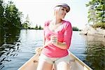 Woman Canoeing on Kahshe Lake, Muskoka, Ontario, Canada Stock Photo - Premium Royalty-Free, Artist: Hiep Vu, Code: 600-03195044