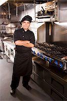 Portrait of Cuban chef standing in restaurant kitchen Stock Photo - Premium Rights-Managednull, Code: 842-03198515