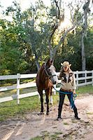 Portrait of young cowgirl with brown Mare horse on farm Stock Photo - Premium Rights-Managednull, Code: 842-03198547