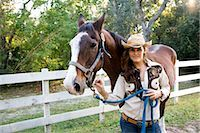 Portrait of young cowgirl with brown Mare horse on farm Stock Photo - Premium Rights-Managednull, Code: 842-03198548