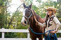 Portrait of young cowgirl with brown Mare horse on farm Stock Photo - Premium Rights-Managednull, Code: 842-03198562