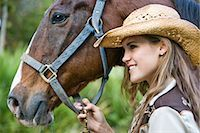 Close-up portrait of young cowgirl with brown Mare horse on farm Stock Photo - Premium Rights-Managednull, Code: 842-03198566