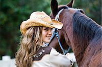 Portrait of young cowgirl with brown Mare horse on farm Stock Photo - Premium Rights-Managednull, Code: 842-03198572