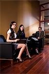 Portrait of businesswomen and businessman sitting in lounge with laptop Stock Photo - Premium Rights-Managed, Artist: Kablonk! RM, Code: 842-03198628