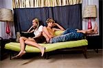 Bored young teenage couple sitting on sofa indoors Stock Photo - Premium Rights-Managed, Artist: Kablonk! RM, Code: 842-03199267